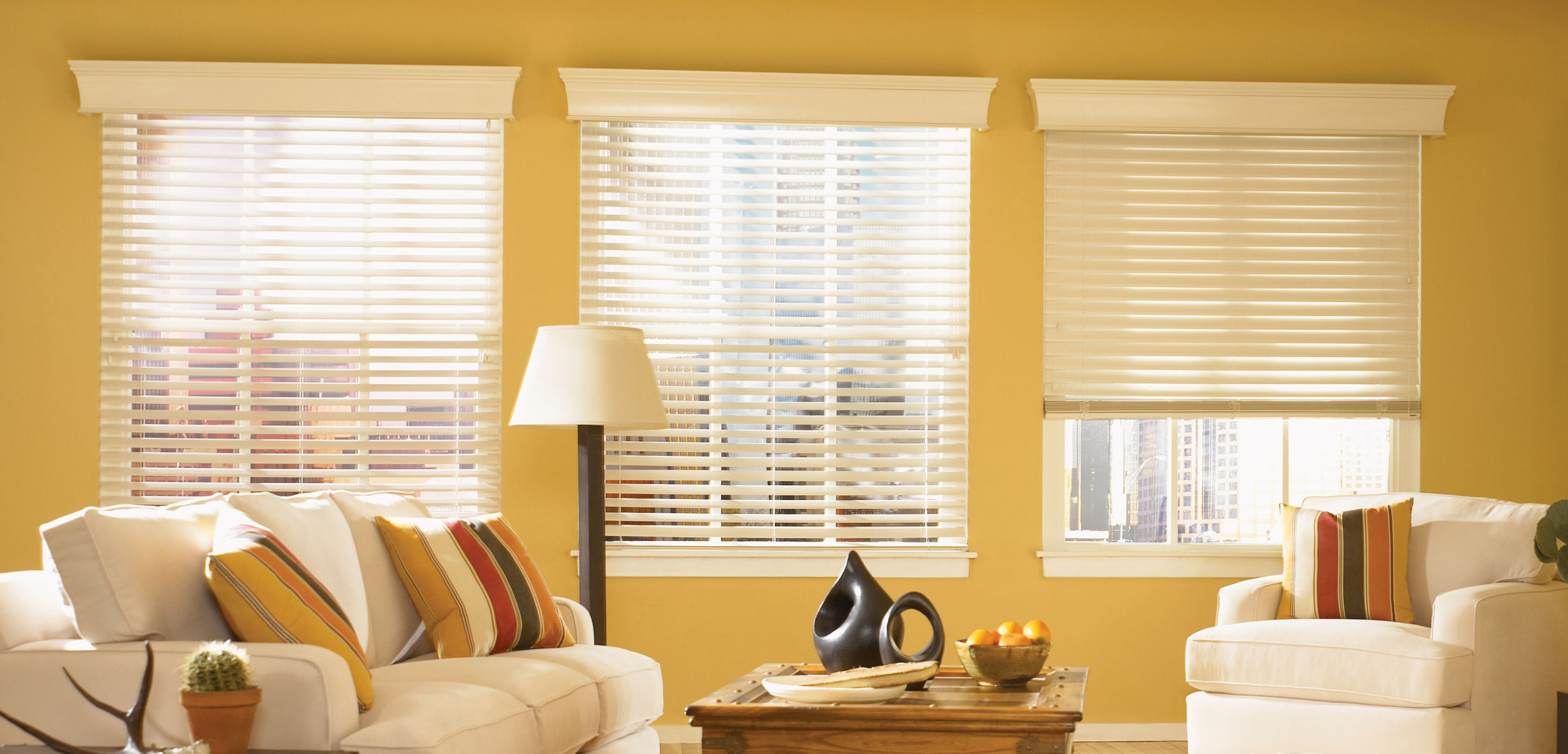 living room with white faux wood Venetian blinds